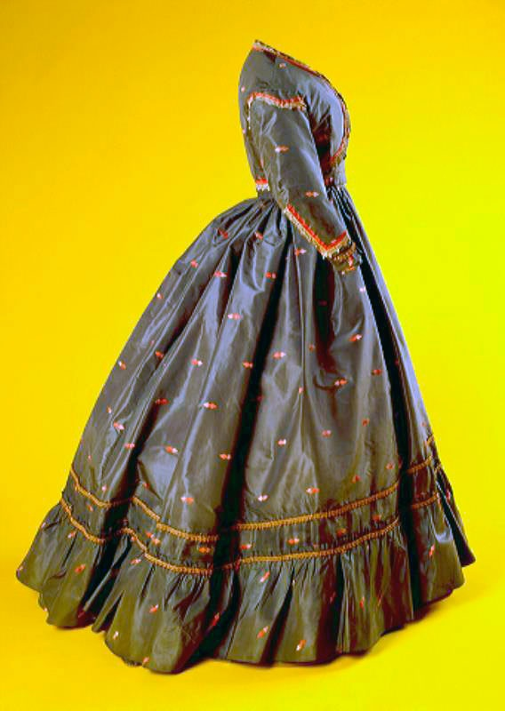 Three-piece gown (bodice, skirt, bolero), circa 1850-1870, of green/gray silk taffeta, with embroidered diamond-shaped figures in pink and white. Bodice has long tight sleeves and center front closure through fabric-covered buttons. Skirt lined in natural-colored cotton, bodice in natural-colored silk. Via Amsterdam Museum.