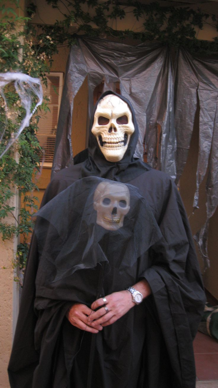 """My amazing Fiance dressed at Grim Reaper....with his tiny diy """"bride"""""""