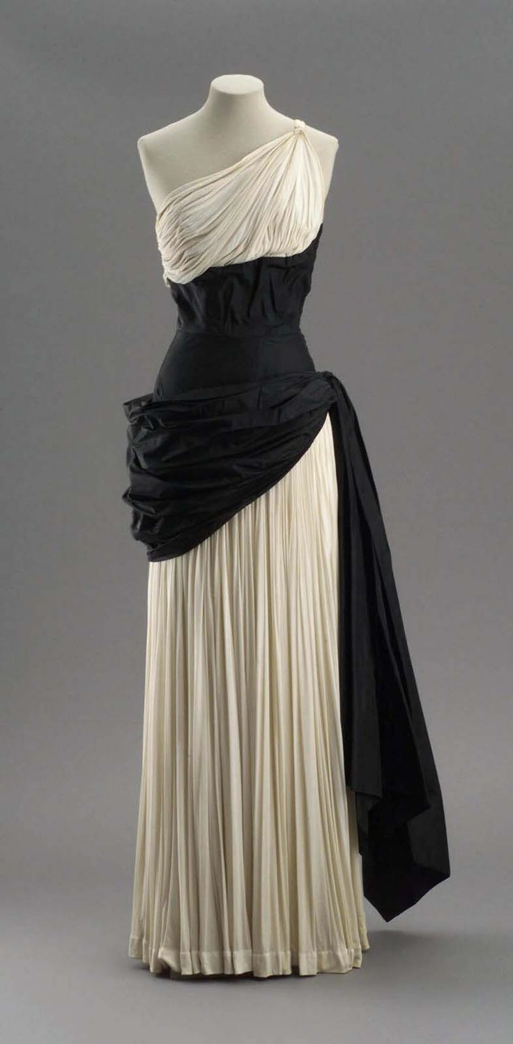 Evening dress of pleated white silk jersey and black taffeta, Madame Grès, early 1950s. [Museum of Fine Arts, Boston.]
