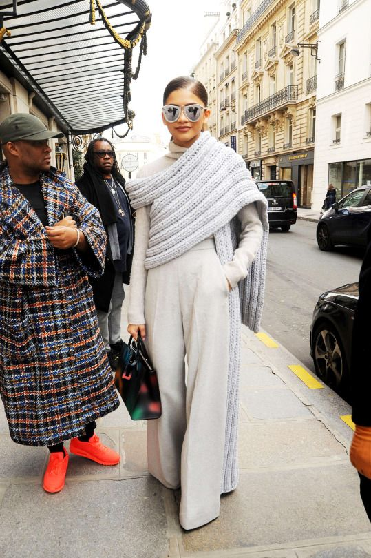 Gorgeous look in very light grey with huge oversized scarf with one sleeve.