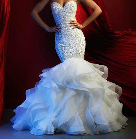 Heavily beaded wedding gowns like this can be costly. Our design firm is located near Dallas Texas USA and can provide rhinestone & crustal beaded #weddingdresses like this for brides for a reasonable cost. We have sold affordable custom bridal gowns (as well as inexpensive replicas of couture gowns) since 1996. You can get pricing on any picture and more details on long distance ordering when you visit our main website.
