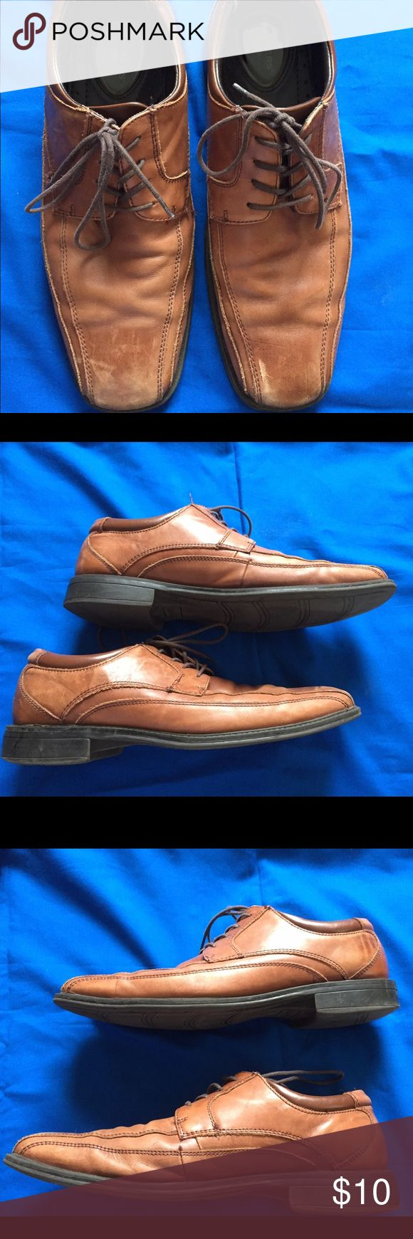 Men's brown Dockers dress shoes Men's brown Dockers dress shoes the front of the shoes are scuffed up can be repaired. Heels and souls are still good. Dockers Shoes