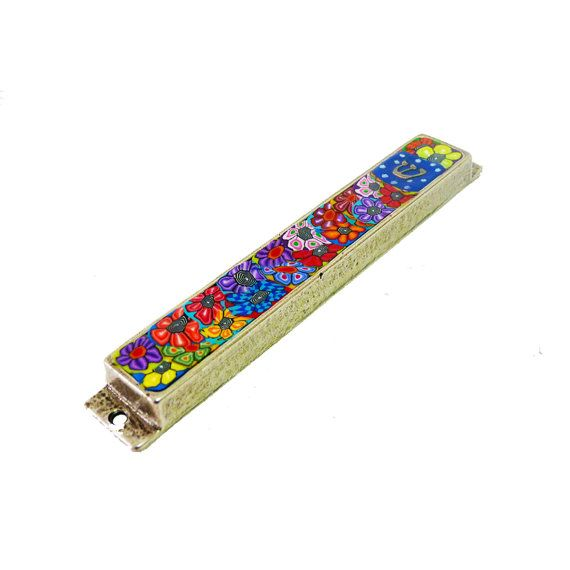 Mezuzah case This Mezuzah is made with silver metal and polymer clay all the flower is made by hand, one-of-a-kind colorful design  *** Scroll is not included in this listing ***  This Mezuzah is app 14.5 cm 6 long Takes a 12 cm 5 scroll   What is a Mezuzah? A Mezuzah is a parchment which we affix to our doorposts, in which a scroll has hand-written two paragraphs from the Torah.  I accept payment via Pay-Pal  All my items are packed and shipped in padded cardboard boxes and/or padded…