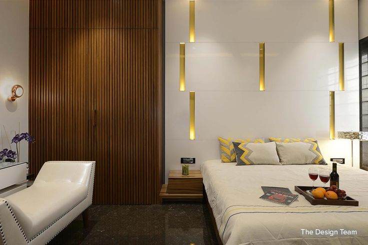 A simple but elegant idea of enhancing your room with a headboard of lights and wood. Here the lights have been concealed behind the paneling. The headboard serves the purpose of reading lights too.  #decoridea #decortip #decor #designblog #decorblog #homz Design Courtesy - The Design Team