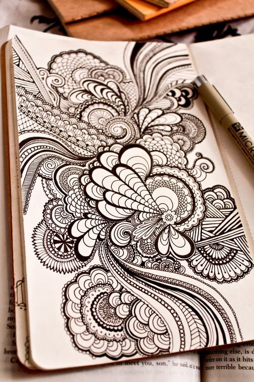 zentangle, large scale.--When I first saw this, it looked like the middle design was raised up for a 3D effect, which gives me a really good idea. I'll have to try my scrapbooking dots with my zentangles and see what it looks like.