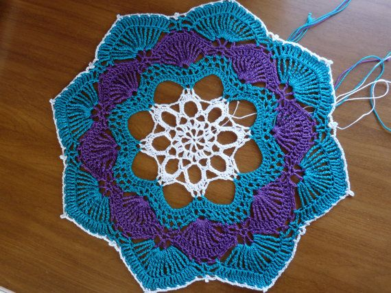 Turquoise and purple always go good together  https://www.etsy.com/listing/201742132/crochet-doily-turquoise-purple