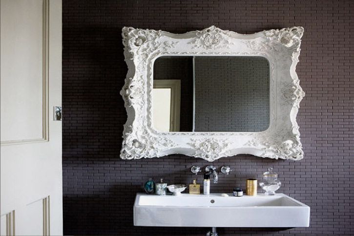 Great mirror for the bathroom. Loving how the white frame pops off the purple wall
