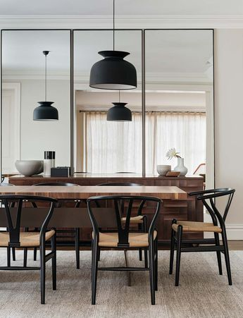 dining room with black wishbone chairs and gubi 'rode' pendant light   Figtree House by Arent&Pyke