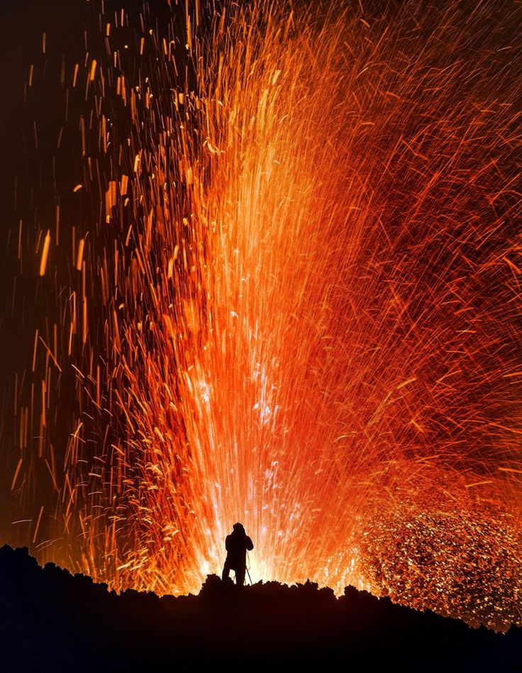 The new photo series shows the eruption of the Piton de la Fournaise volcano on Reunion Island in all its flaming, raging glory.