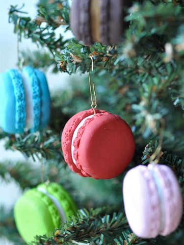 Give your tree a French twist by adding these colorful sweets! These faux macaron ornaments can be made using either polymer clay or fondant. Get the tutorial at Creative Juice.   - CountryLiving.com