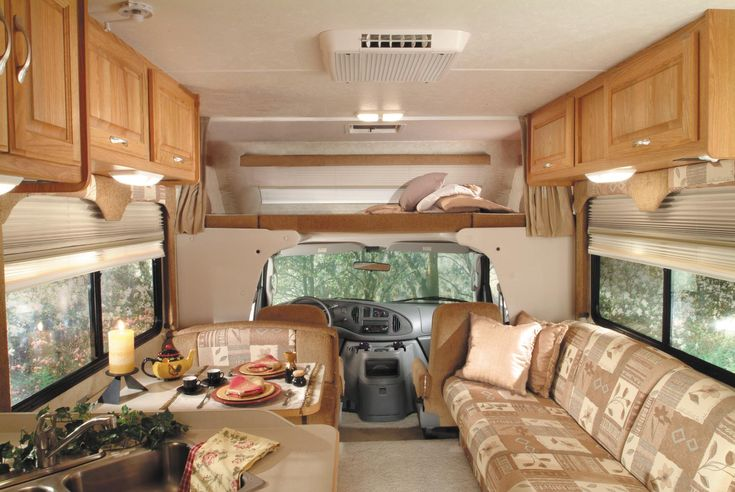 This picture shows the front of a Class C motorhome where the driver sits and the accommodations immediately behind the driver. This photo may be reused by anyone with link-back attribution, such as one of the following: This photo is used with the permission of El Monte RV Rentals. HTML: …