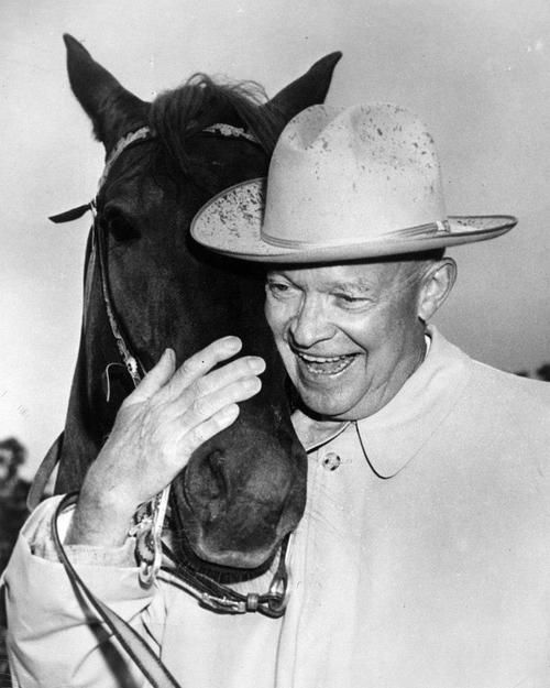 President Dwight D. Eisenhower with his horse, Doodle De Doo. The horse was a gift to the President from the Quarter Horse Association and was kept at Eisenhower's farm in Gettysburg, Pennsylvania.