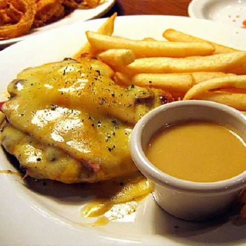 "OUTBACK STEAKHOUSE ALICE SPRINGS CHICKEN RESTAURANT RECIPE: ~ From: ""Secret Copycat Restaurant Recipes."" ~ Alice Springs Chicken is one of the most popular dishes at Outback and my favorite dinner — though overall it might lose out to the Bloomin' Onion as my favorite thing on the menu. ~ SERVE WITH OUTBACK HONEY MUSTARD."