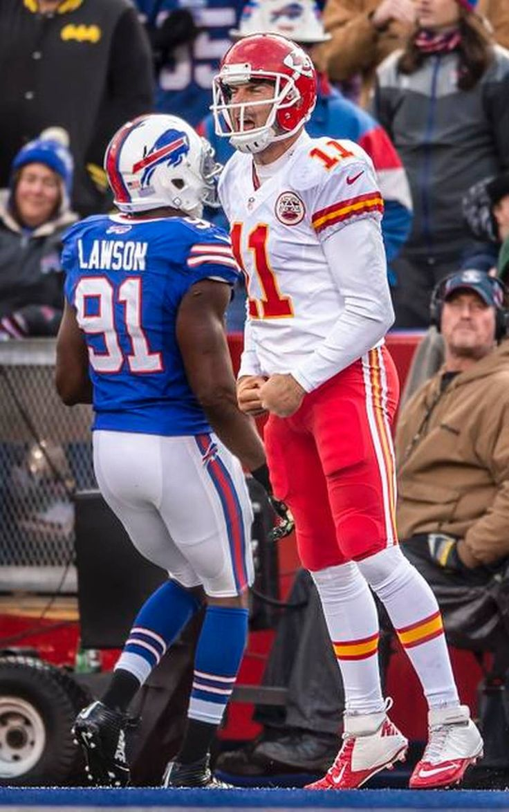 Kansas City Chiefs quarterback Alex Smith (11) leaped up in celebration after scoring the winning touchdown in the fourth quarter past Buffalo Bills defensive end Manny Lawson (91) during NFL action on November 9, 2014 at Ralph Wilson Stadium in Orchard Park, NY. The Chiefs won 17-13.
