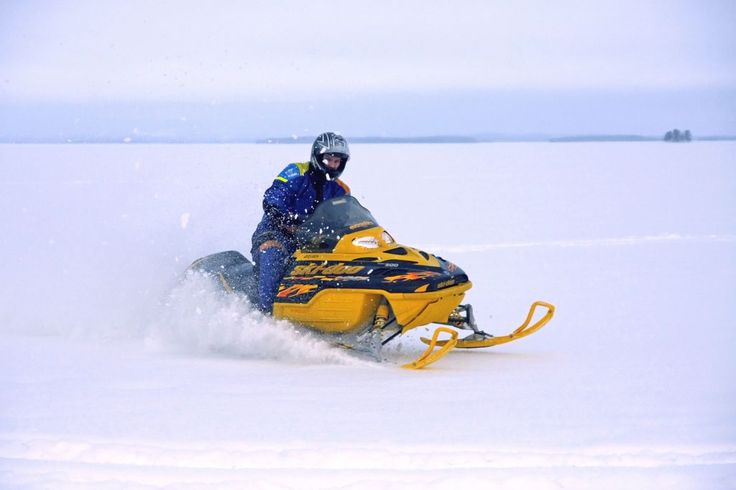Snowmobiling on a frozen lake in Karelia