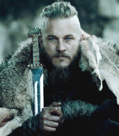 Ragnar, played by Travis Fimmel.  I thought it was Charlie Hunnam at first. They have a similar look and acting style.