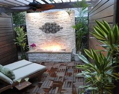 Natural Outdoor Fireplace Patio tropical patio