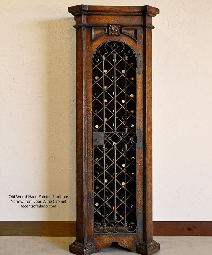 As beautiful as it is hard-working, this old world iron door wine cabinet holds more than 50 bottles of your favorite vino.. torched brown hand painted finish.. see it at accentsofsalado.com.