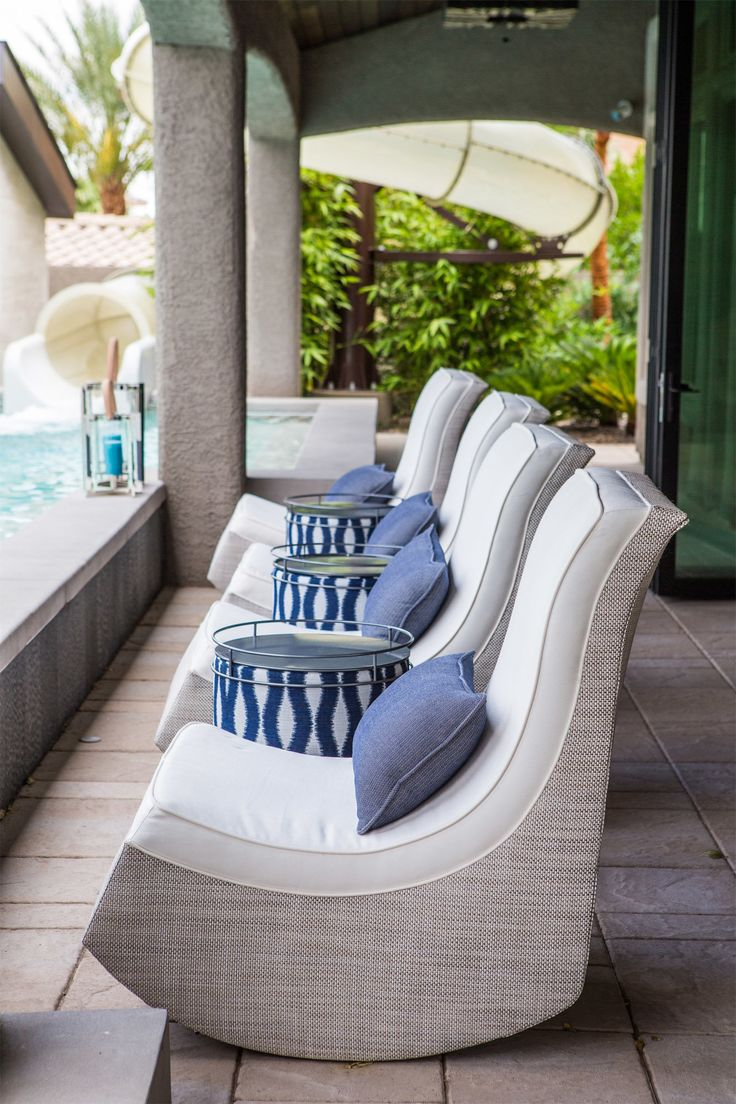 The Scott brothers' outdoor porch, complete with contemporary rocking chairs overlooking the pool, complete with swim-up bar and water slide.