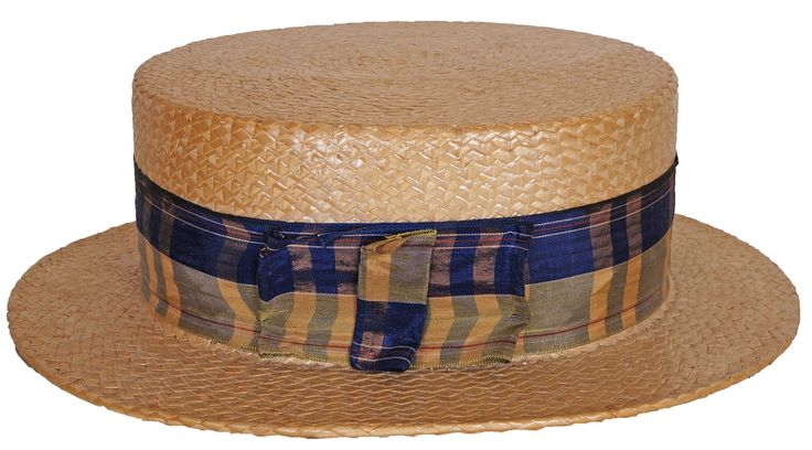 "Age: 1920s Label: Unidentified Japanese Label, gold-stamped with crowned winged symbol Colour: Tan Straw and Blue Ribbon Materials: Straw and Silk Ribbon Sizing: 7 1/4"" size; interior dimensions of th"