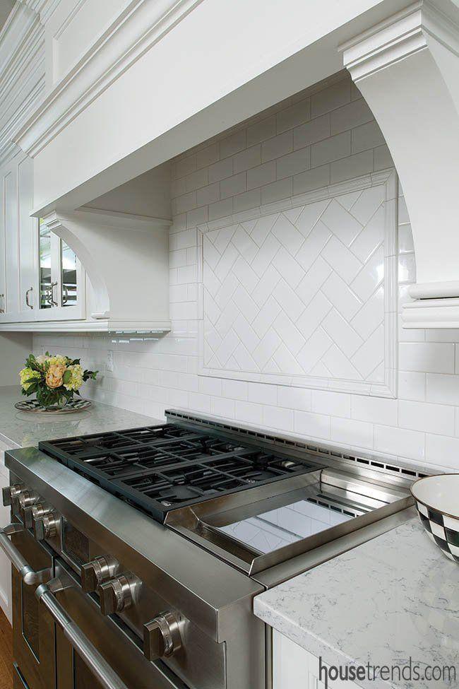 Subway tile backsplash in a herringbone pattern