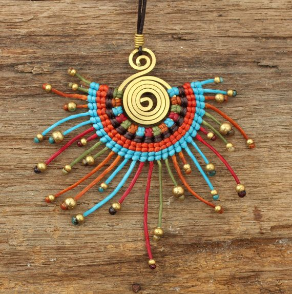 Funky tribal waxed cotton pendant in red and blue tones with brass highlights