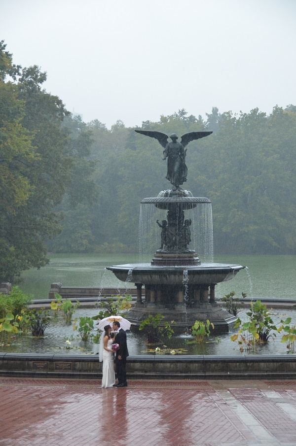 Gorgeous shot from a rainy day wedding at Bethesda Fountain in Central Park / Photo by jessicaschmittphotography.com