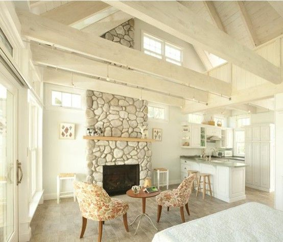 Small Cottage Living Room Ocean: Whitewashed Stone Fireplace