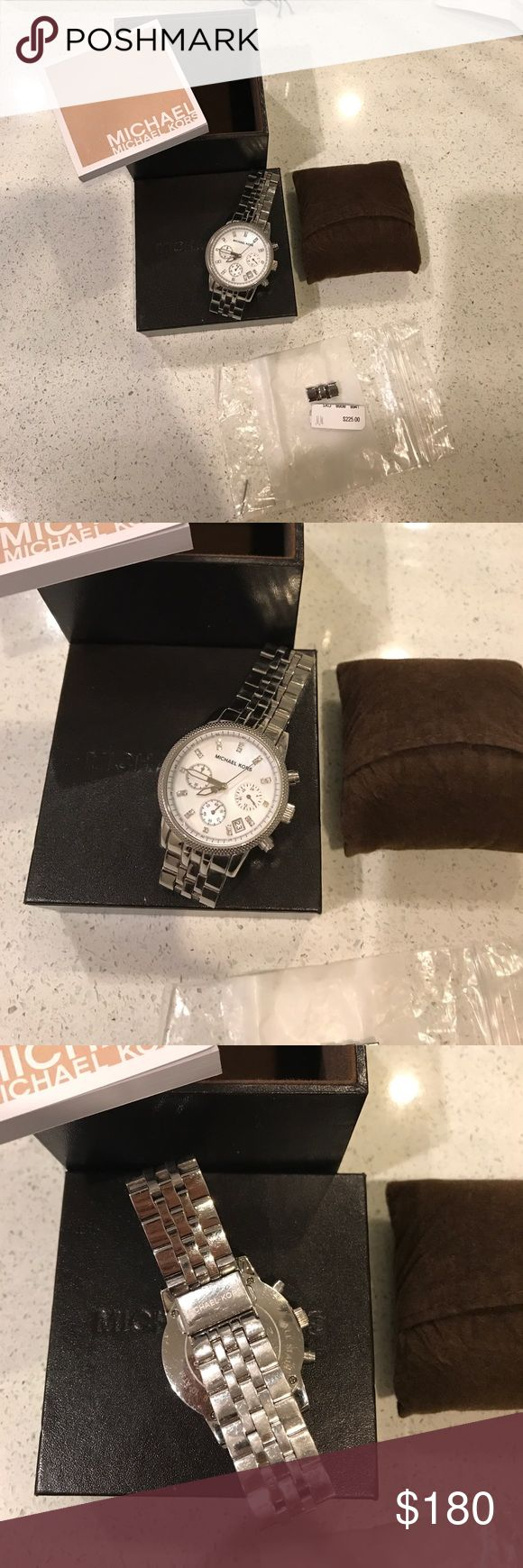 Michael Kors mother of pearl silver watch Michael Kors mother of pearl watch has been worn several times was bought at Neiman Marcus!!! Michael Kors Accessories Watches