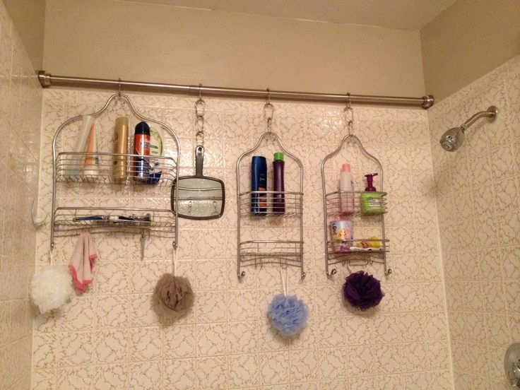 Easy shower organization for a family of five. Shower Rod across the back of the shower and designated racks for each person. Ma and Pa are sharing the big one, big brother has his own, and the two little girls share one.