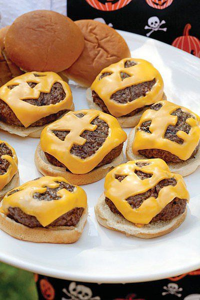 Jack-'o-Lantern Cheeseburgers: An easy Halloween dinner idea, Sandra Lee's jack-o'-lantern cheeseburgers are sure to be a hit with your kids. Source: Sandra Lee