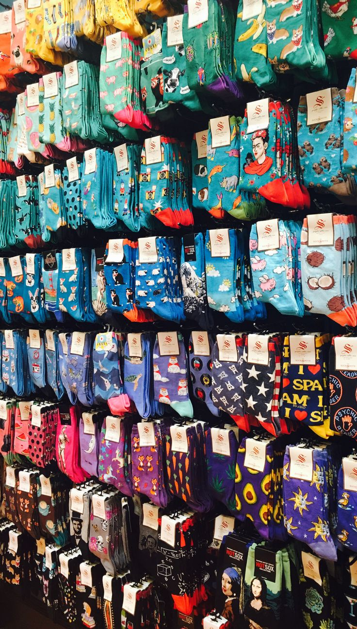 Crew socks arranged by hue make for a colorful, eye-catching product display.