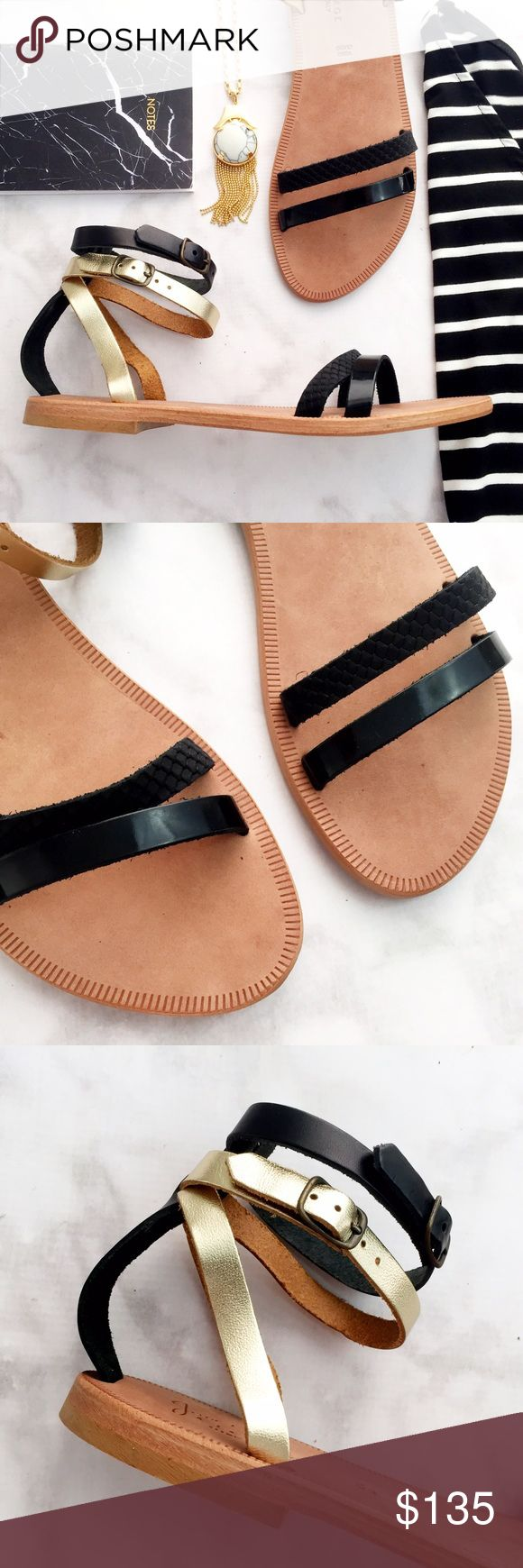 Black and Gold Strappy Flat Sandals Details: * Size 39/9 * Black patent leather and embossed leather straps across the toes * Black and gold straps around the ankles * Brand new in box 06211608 Joie Shoes Sandals