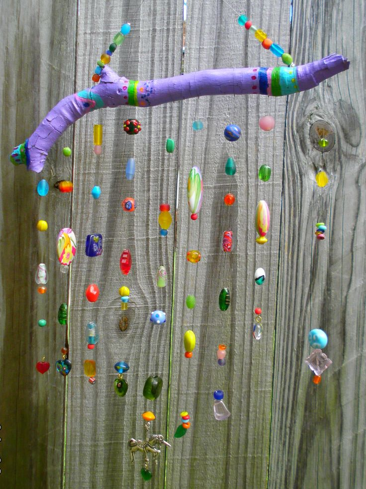 Painted stick and beads.