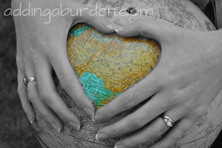 "Love this alternative ""maternity"" session for adoption. Instead of a heart around her belly, she put the heart around Russia, where they're adopting from. :)"