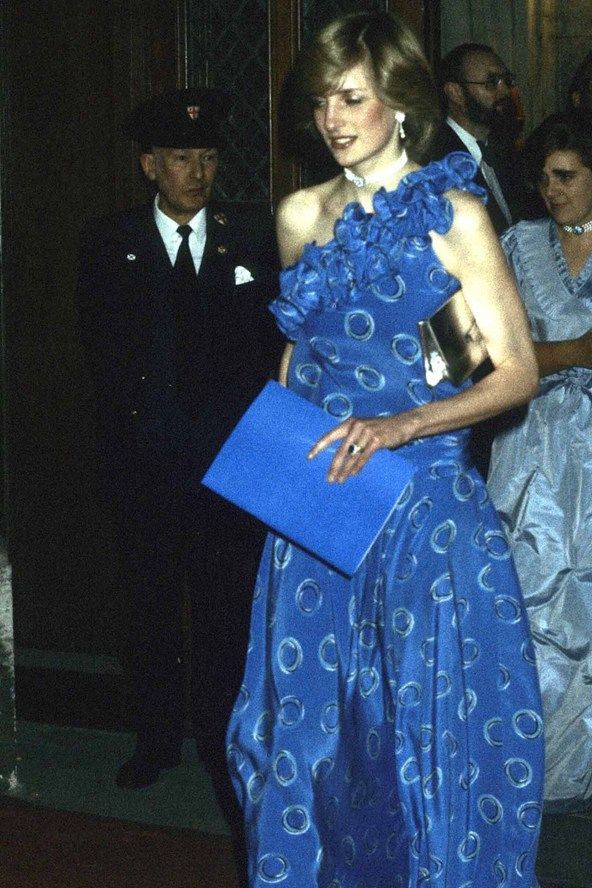 Diana attends a banquet in Guildhall, London in November, 1982. This Bruce Oldfield midnight blue dress caused a frenzy amongst the fashion press. The Princess startled her critics by stepping out in a dramatic dress that moved around her slender frame, mere months after giving birth.