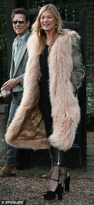 Glamour girl: The supermodel stepped out in a decadent fur coat and platform heels with husband Jamie following on behind her