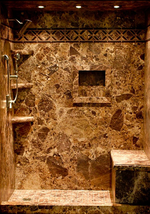 """Create a """"stone"""" shower with PVC backed composite wall panels which are excellent for a DIY 'er. They can go over old tile and have the look of real stone at a lower cost."""