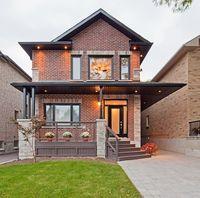 Red brick house, dark trim