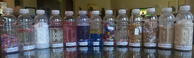 Science for kids, why yes! 13 bottles with different science principles (density, static electricity, magnetic, sink or float).  Made from old water bottles and with most things found around the house. genius!