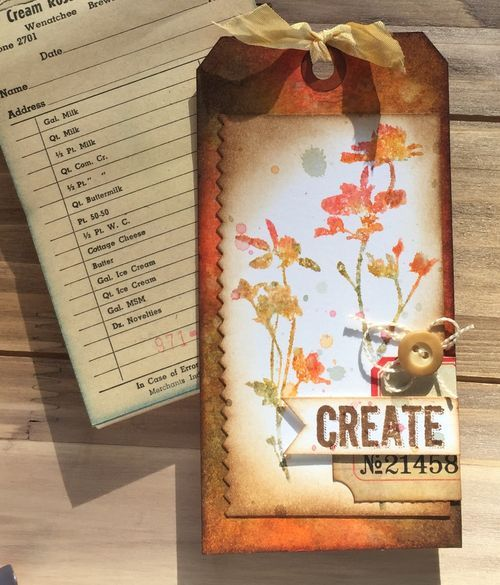 By Chelle Fowler. Ink stamp with corners of Distress ink pads: worn lipstick, dried marigold, wild honey, and iced spruce. Spritz stamp with water. Stamp on watercolor paper.