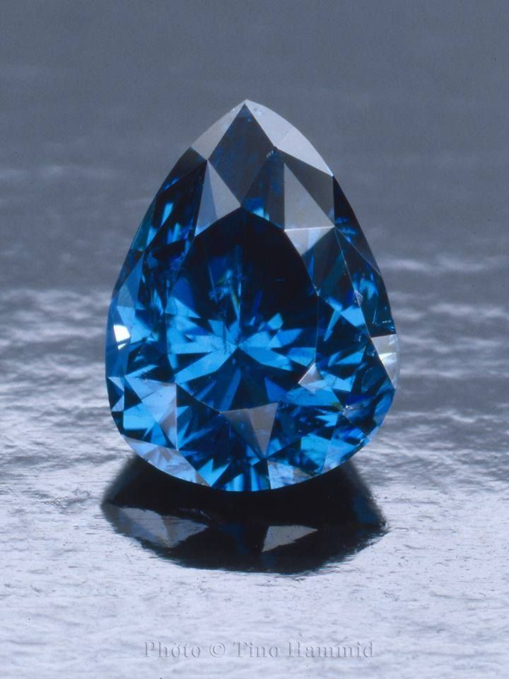 This gemstone could easily be mistaken for a blue sapphire but in fact it is one of the most intensely coloured blue diamonds ever found.  It's small at .51 cts but big on color