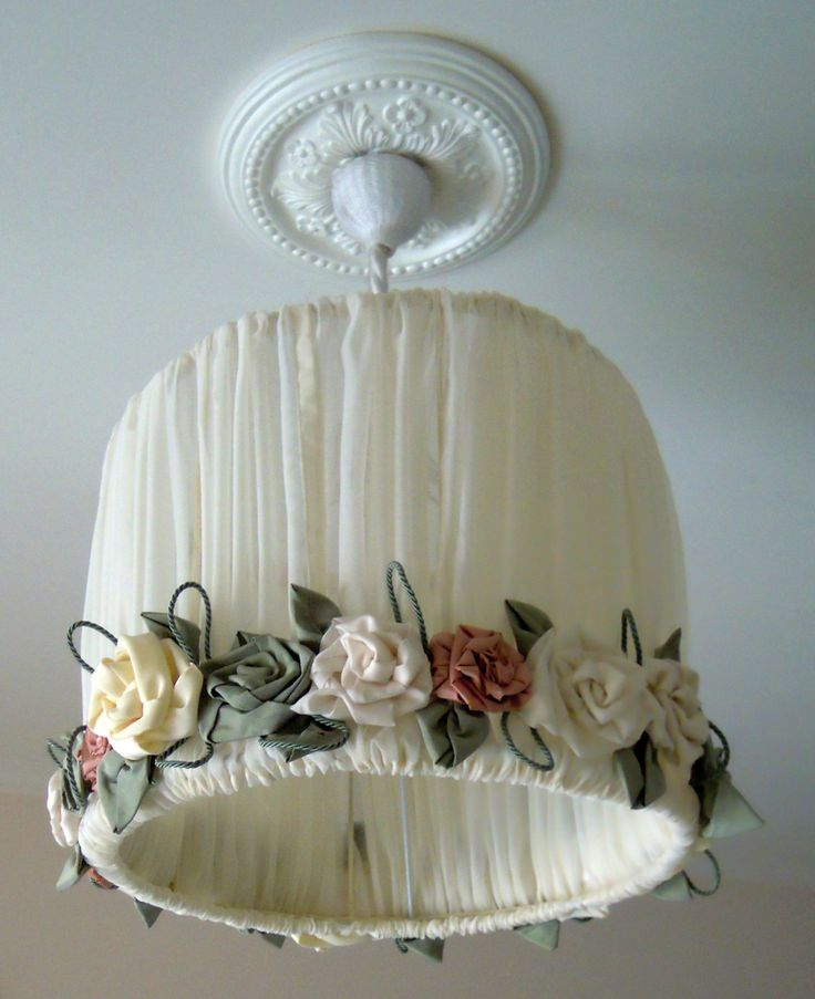 Chandelier pure linen with rose garland with handmade removable. Structure in metal painted white, completely covered in fabric.  (Bulb not included).