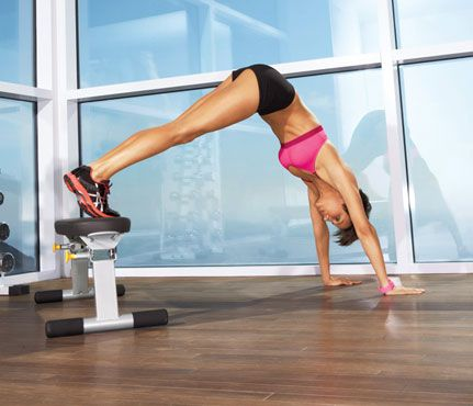 Bear Walk     Start in plank with toes on bench. Engage abs as you walk hands toward bench until body forms an inverted V (as shown). Walk back to plank for 1 rep. Do 5 reps.