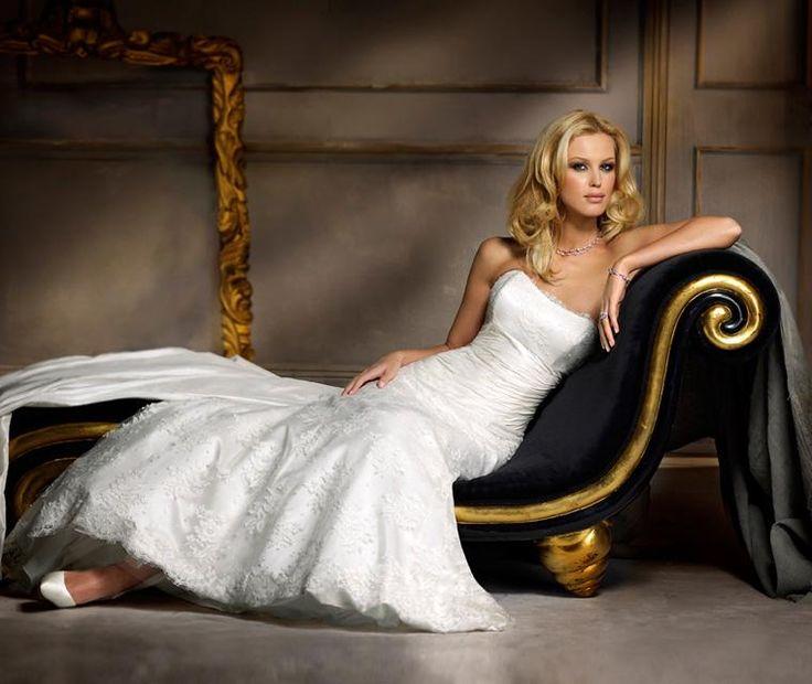 Maldives  Stunning A-Line lace wedding gown with taffeta midriff and detachable taffeta train.