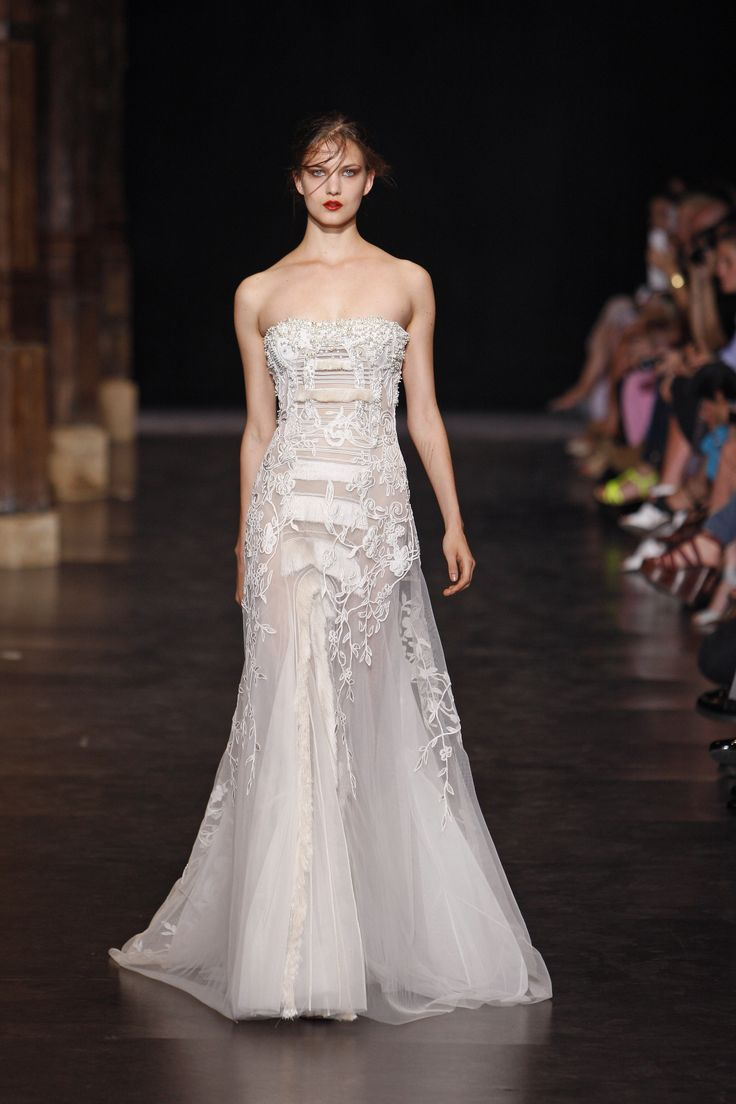 Floor length strapless couture gown with detailing
