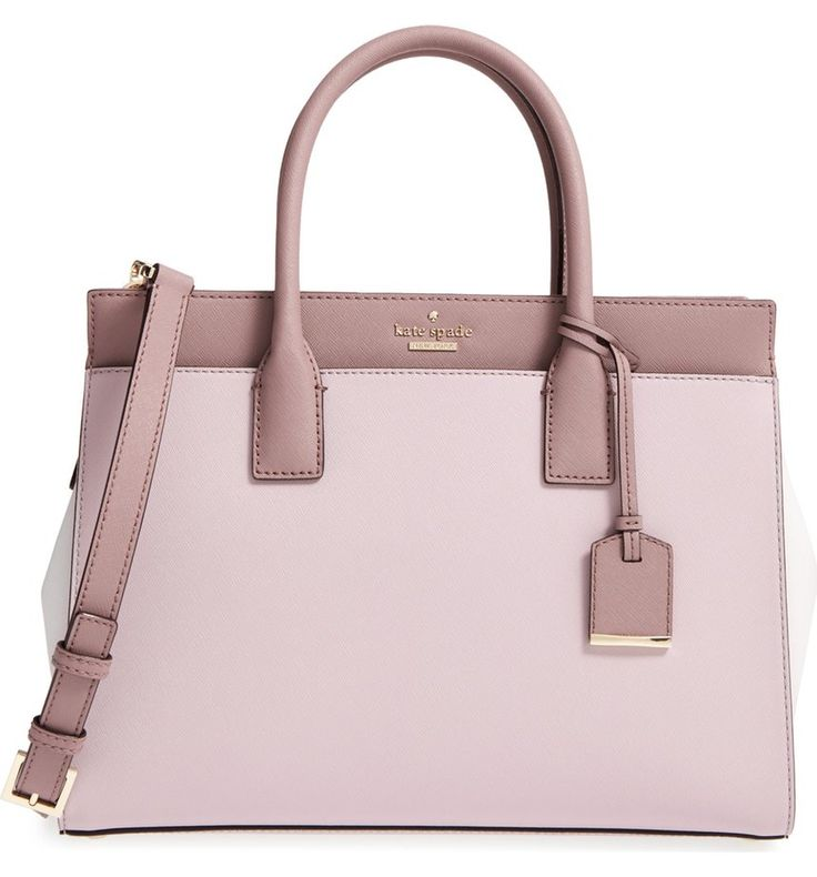 This smartly designed Kate Spade bag features three separate, spacious compartments for organizational ease, while top handles and a removable shoulder strap offer stylish carrying choices.
