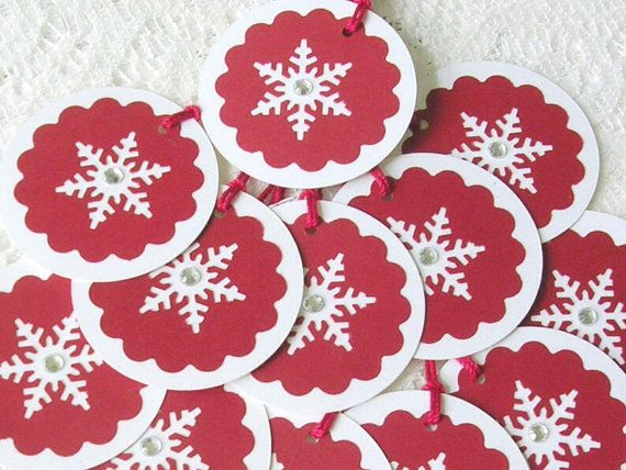 "A deep red scallop circle is center punched with a snowflake and mounted on a 2.25"" diameter white shimmer cardstock circle. Tags have blank"