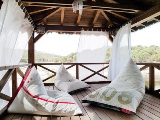 Salvaged ship sails re-purposed by DVELAS as outdoor furniture. Love it!