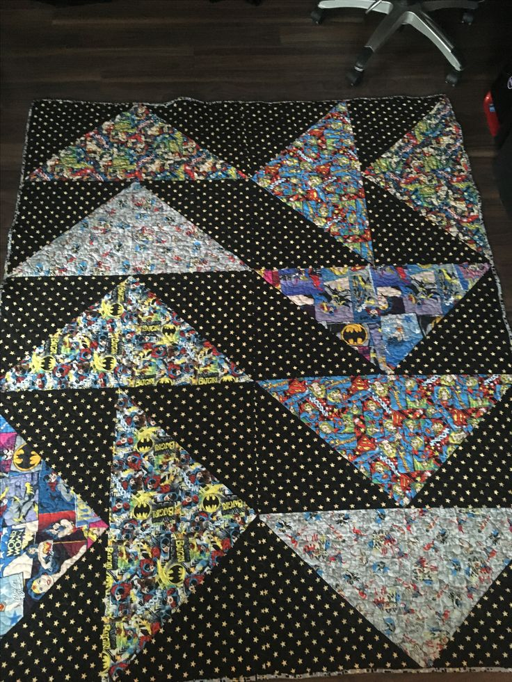 Quilted Legacy- Binding the Generations. Custom quilting and services. Large flying geese, super hero Quilt.